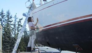 Polishing the topsides, and we all have to face it - Jeanne Socrates, oldest ever non-stop female solo circumnavigator, at work on Nereida - photo © SW